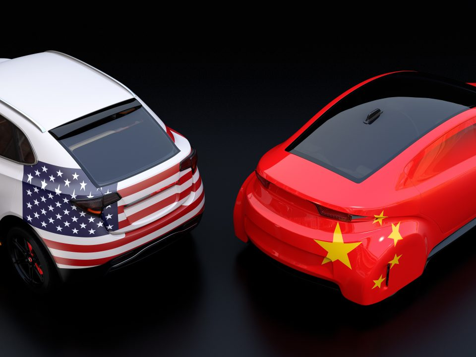 Two cars showing United states and Europe Tariff war